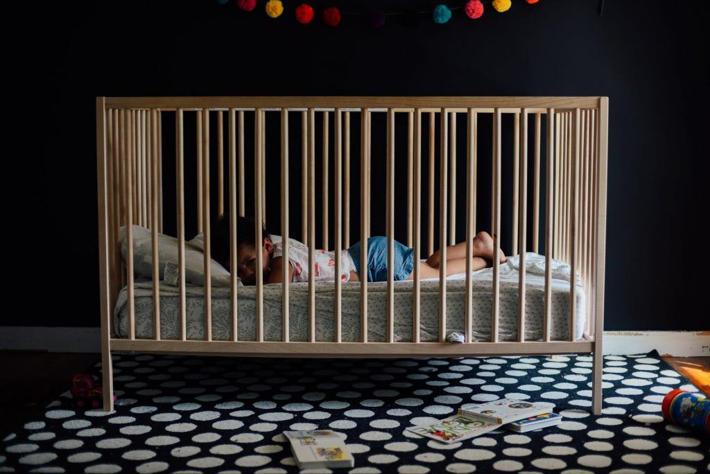 Baby inside a Wooden Crib